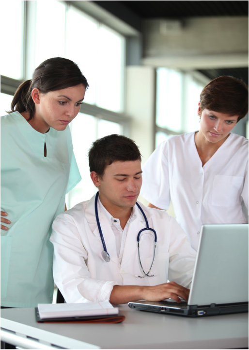 doctors around computer Health IT technology